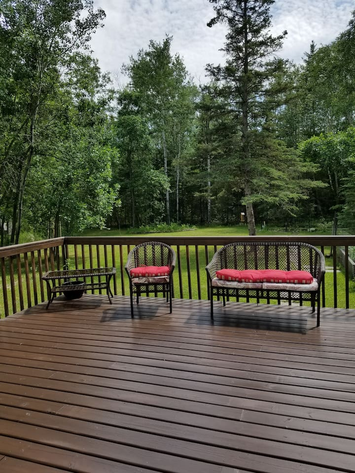 Large serene deck to hang out under the stars with a cup of tea or a nice glass of wine.