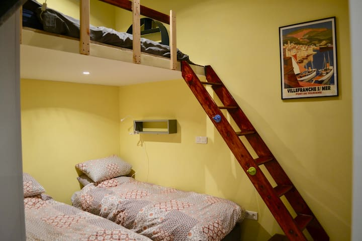 Two single beds in this room plus a double mattress on the mezzanine level.  Reading lights and shelves for each bed.