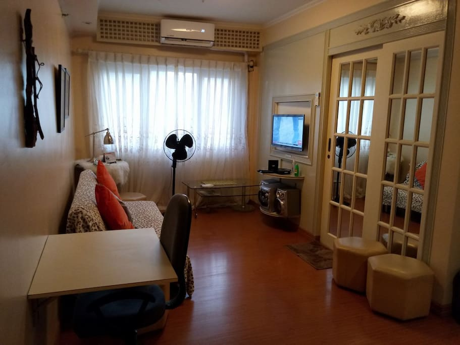 Living Room with sofabed, Cable TV & Wifi, Laptap friendly work space
