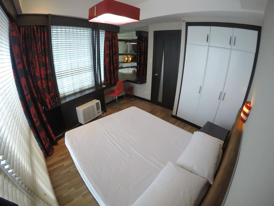 Master Bedroom has full size wardrobe and floor-to-ceiling windows facing east (rising sun)