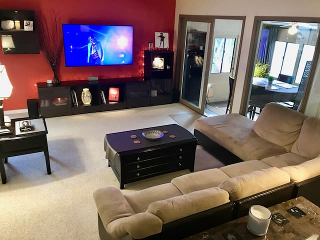 Shared Living Room with large TV, stereo, and cozy couch.