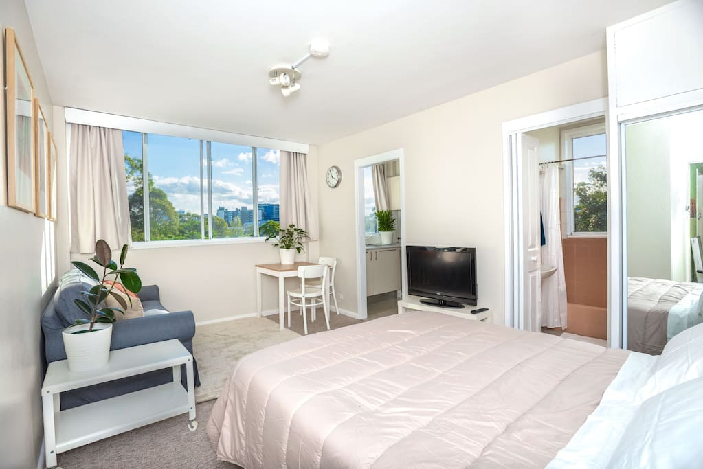 The main space has a two seater couch, a very comfortable queen size bed, a TV, a dining table and more importantly great sunset views!