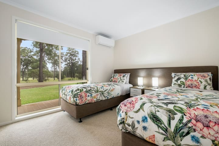 Bedroom with either 2 king singles or 1 king bed. There is also a built in wardrobe, and AC so you can heat or cool the room as you sleep. Don't forget to let us know the configuration you would like with the beds.