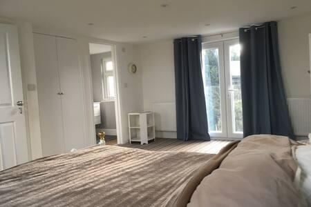 Spacious loft room offering bedroom with en-suite