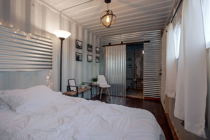 The guest house shipping container has a fully functional bathroom.
