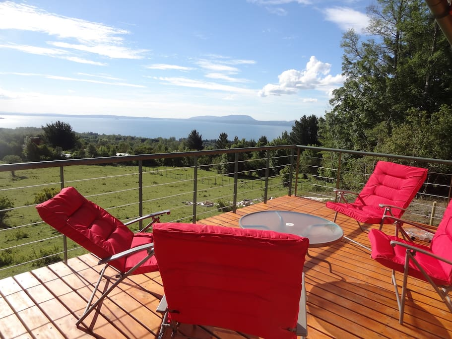 View Deck with reclining deck chairs and table.