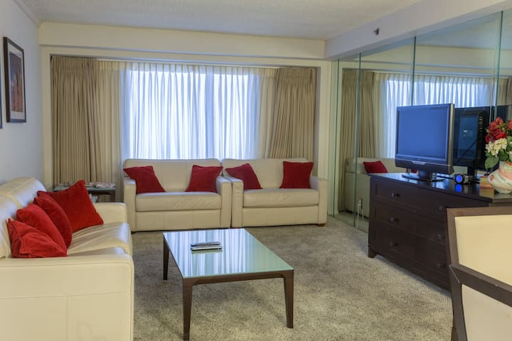 Large comfortable living room equipped with a TV for your entertainment.
