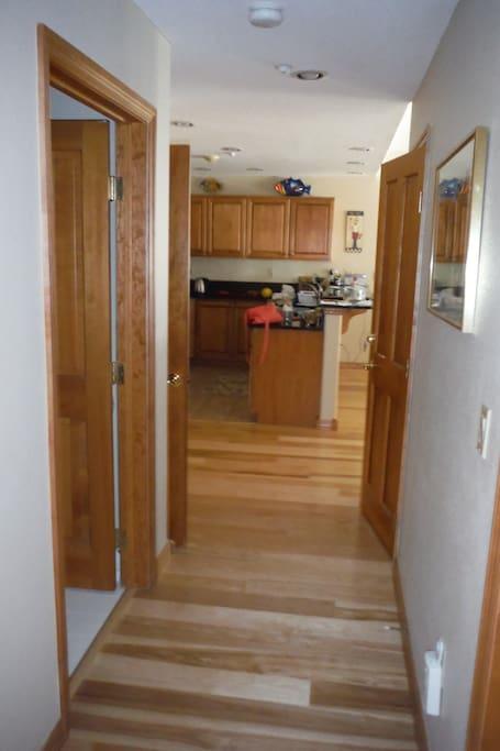 Granite countertops, stainless steel appliances, wood floors.