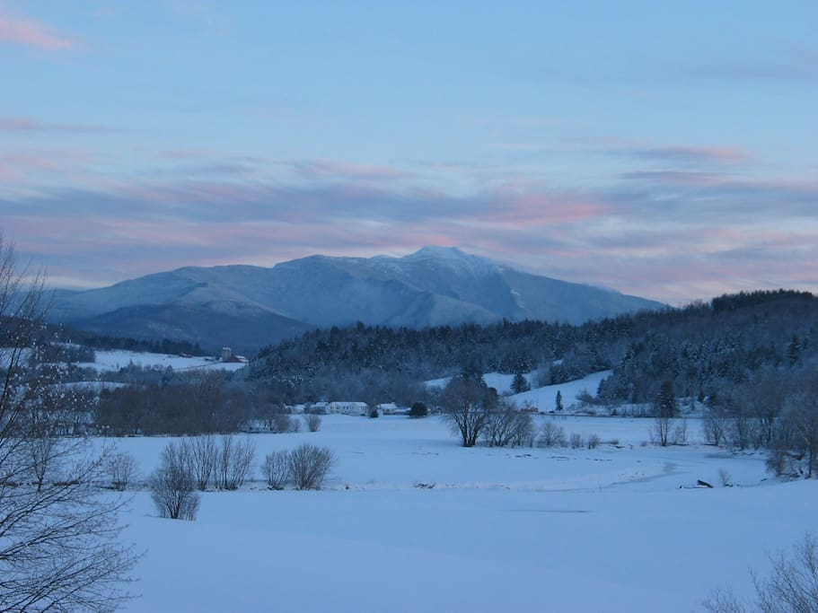 A beautiful sunset on our snowy Mt. Mansfield.  Each moment is a different view.  What a show!