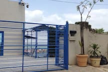 Electronic gates, parking area and entrance to lower apartment