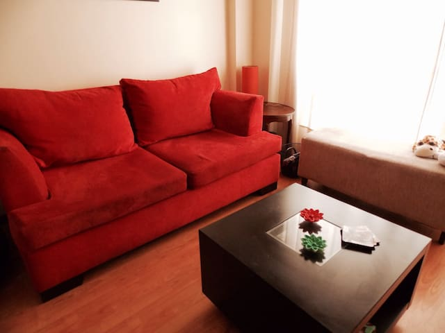 Fully furnished living-room as depicted.