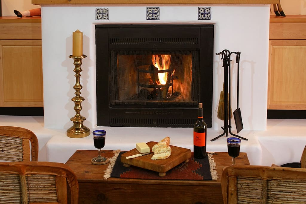Relax by the fire with wine and cheese.