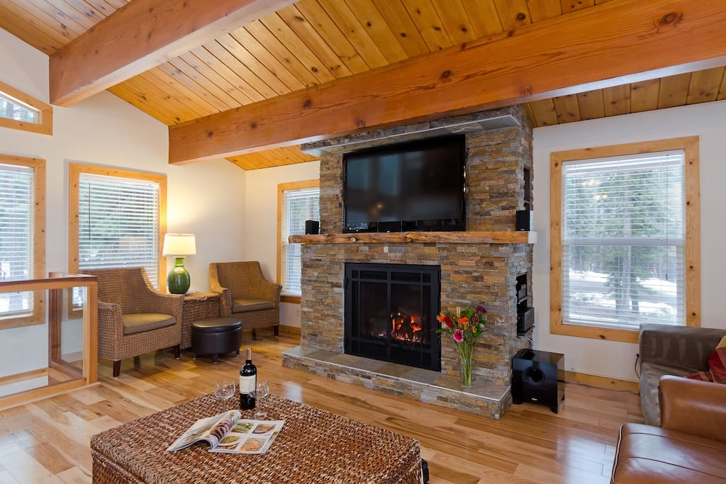 Living area with fireplace, cushioned seating and cable TV