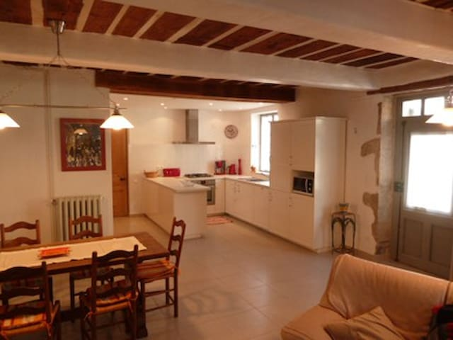 The kitchen is fully equipped and has an adjoining dining and living area.