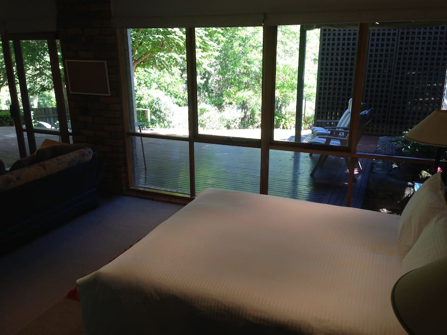 Bed looks out to bush garden