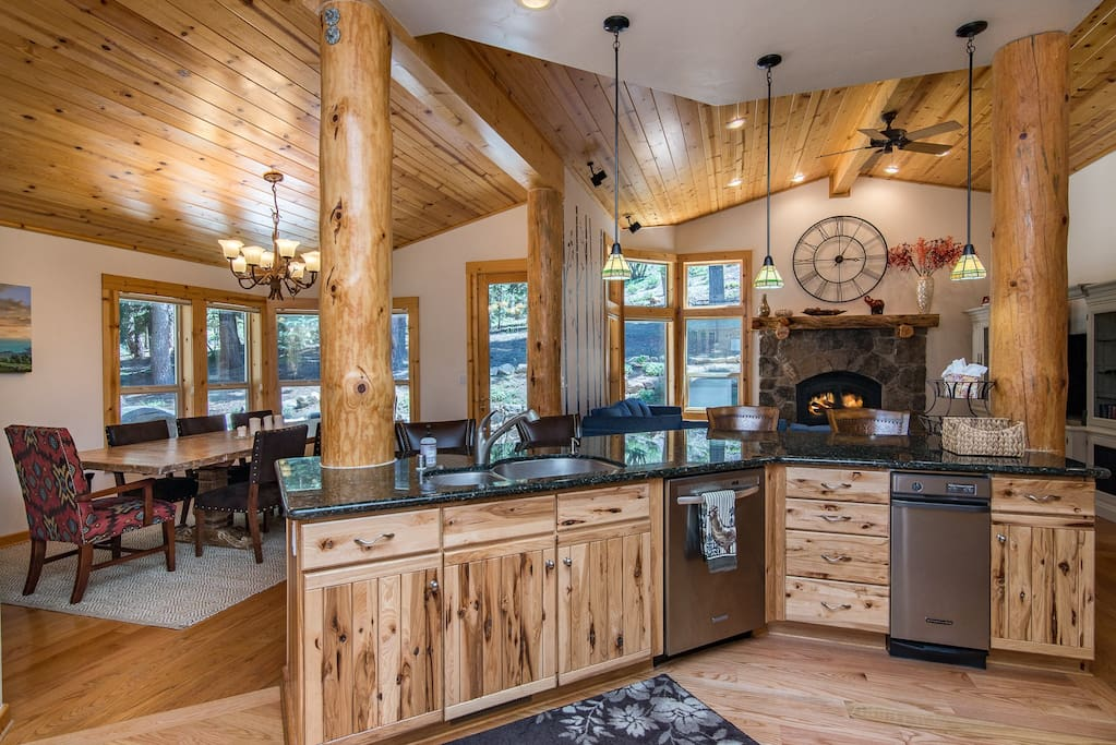 The expansive kitchen opens into the main living and dining area.