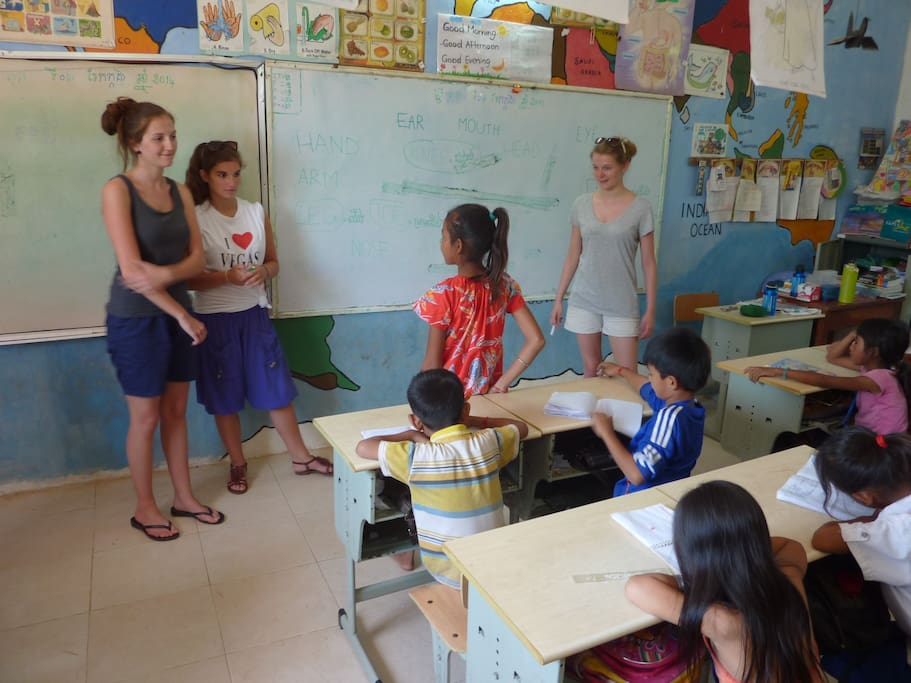 Belgium volunteers teaching our pupils at our island school in Saang.