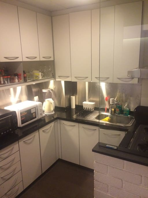 Oven, microwave, double-hob gas cooker, sizable fridge and freezer