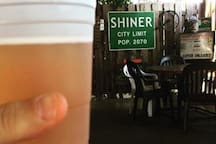 Grab a beer, listen to live music, and meet the locals at Howard's gas station Shiner, TX