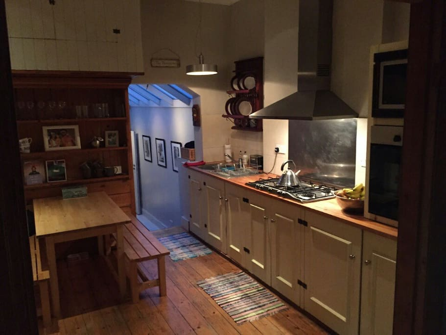 Open kitchen leading to two bedrooms and garden.