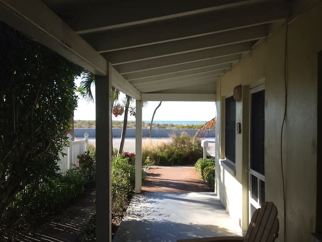 Exit your double French doors to the walkway to the beach