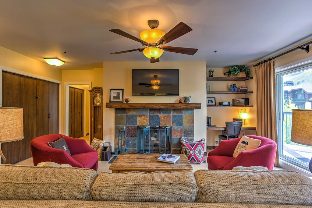 Share quaint evenings in front of the wood-burning fireplace in the living room.