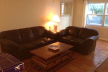 Relax on comfy couches after a day at beach across street!