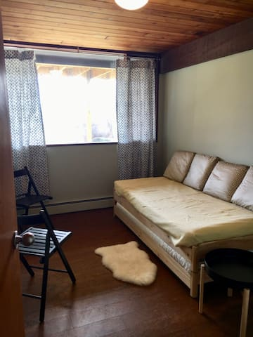 The smaller downstairs guest room features two single beds.