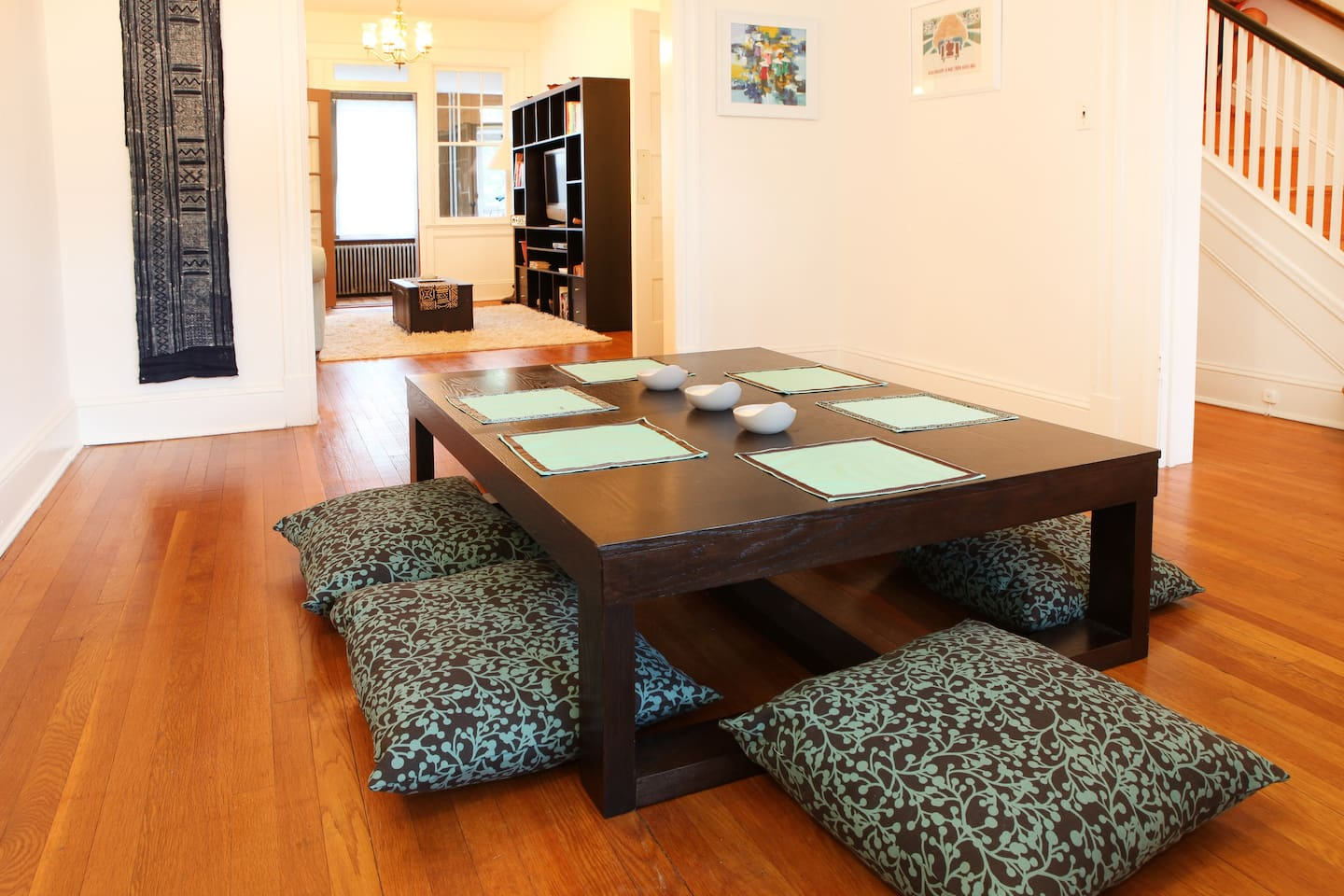 Dining room with asian-style table.  You can see the living room through the back