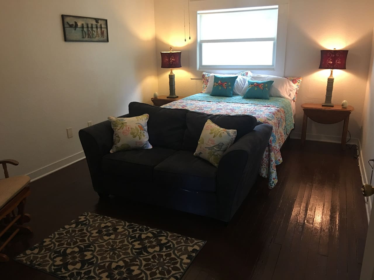 Extra large bedroom with comfy memory foam top queen bed and sitting room for watching tv.