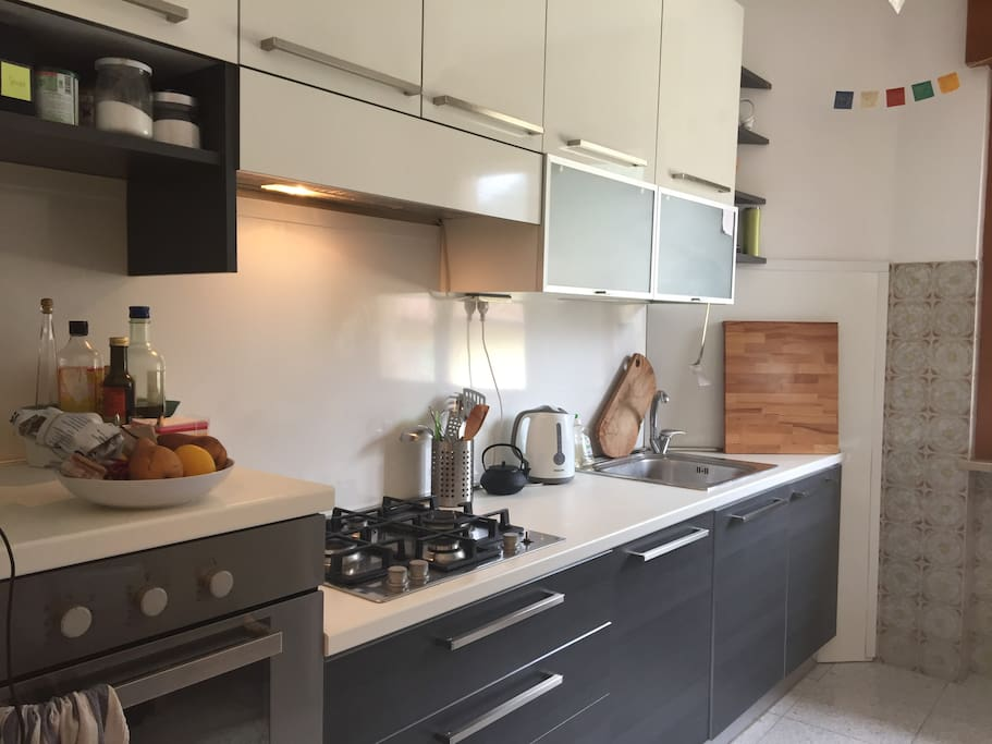 A kitchen supplied and designed for people who cook.