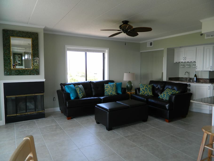 Living area with pull out sofa, wet bar and fireplace.