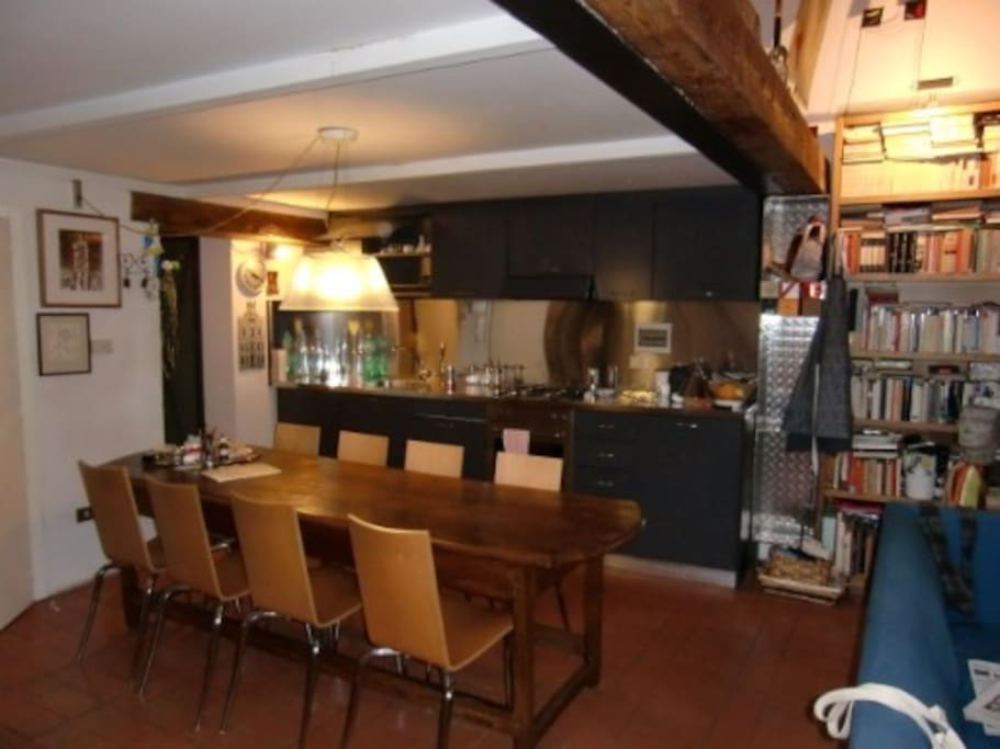 dining table with open plan kitchen