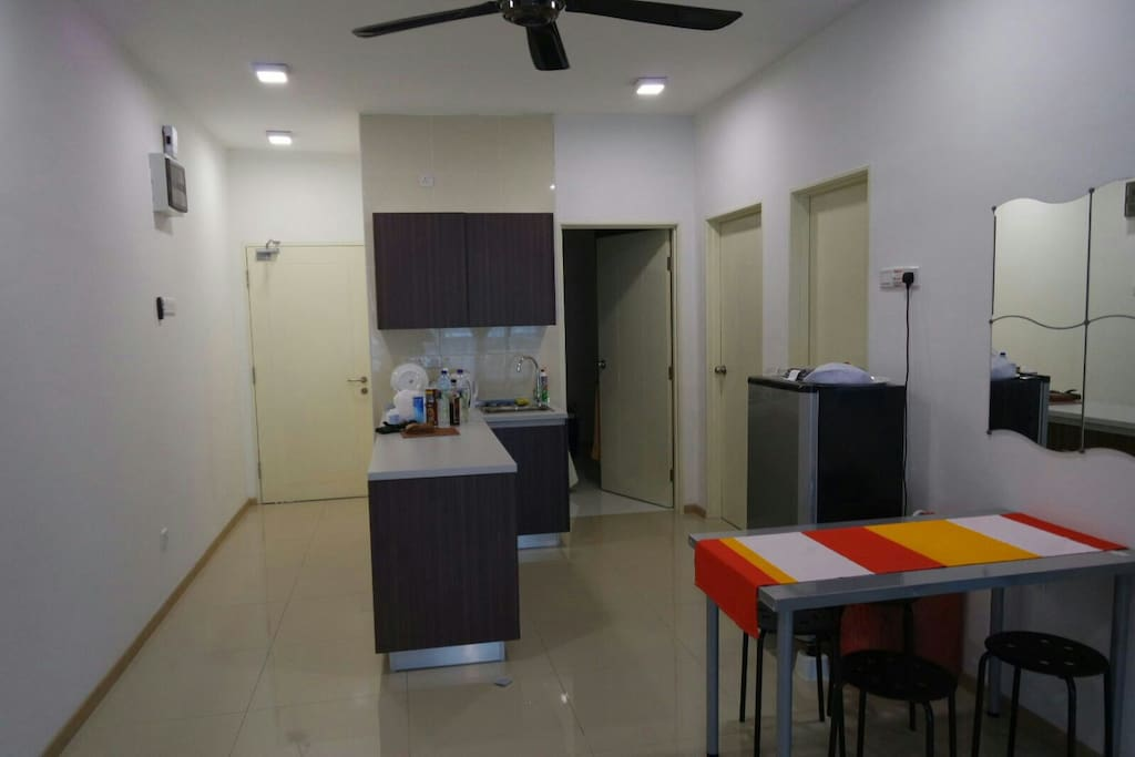 Kitchen Cabinet with Refrigerator, Microwave, White ware, and cute dining table