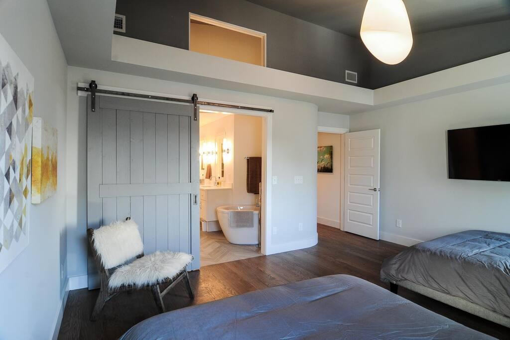 Bedroom 2: Master bedroom with en suite luxurious bathroom. 2 Queen beds and a TV in bedroom.