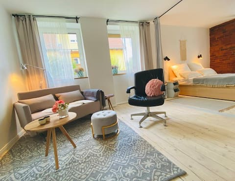Quiet city apartment with loft flair and sauna