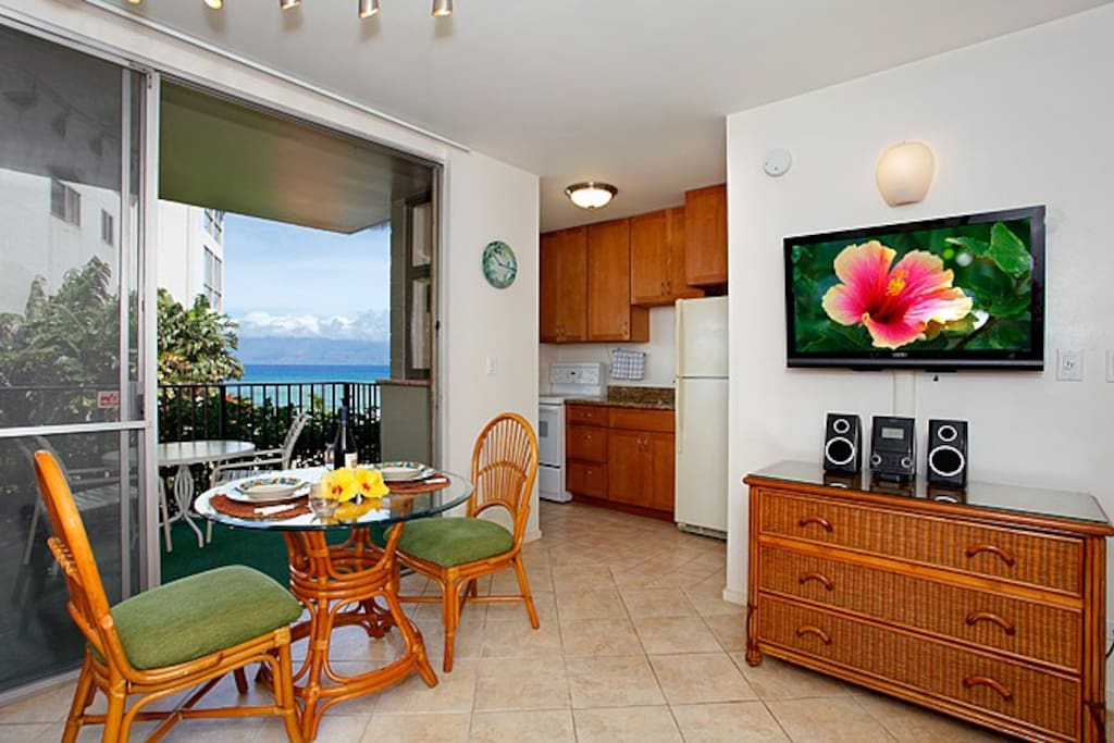 Enjoy dining in for breakfast, lunch or dinner. Wall mounted HDTV and stereo player for relaxing