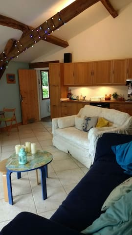 Your sitting room, showing the kitchen behind