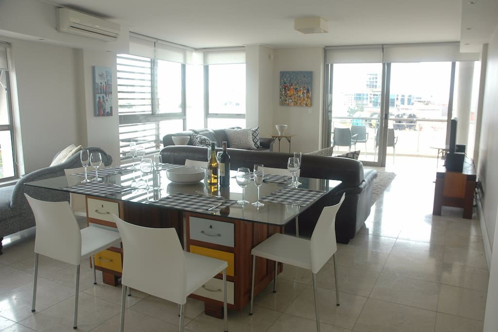 Very spacious, modern open plan dining and lounge area. Travertine marble floors. Airconditioned.