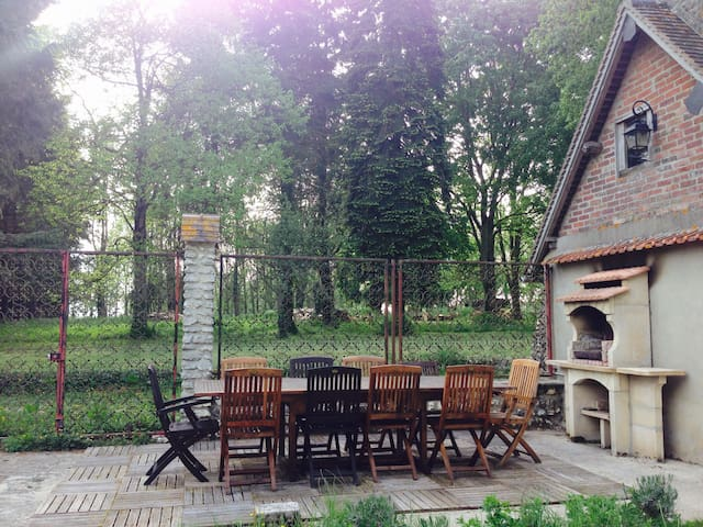 Charcoal barbecue and outdoor dining area