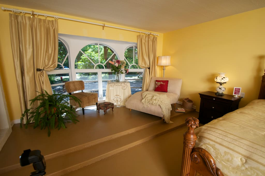 Your own in room private sitting area to relax and look at the flowers, trees and birding just outside your window.