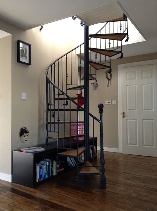 Living Room with Spiral Staircase - not very child friendly