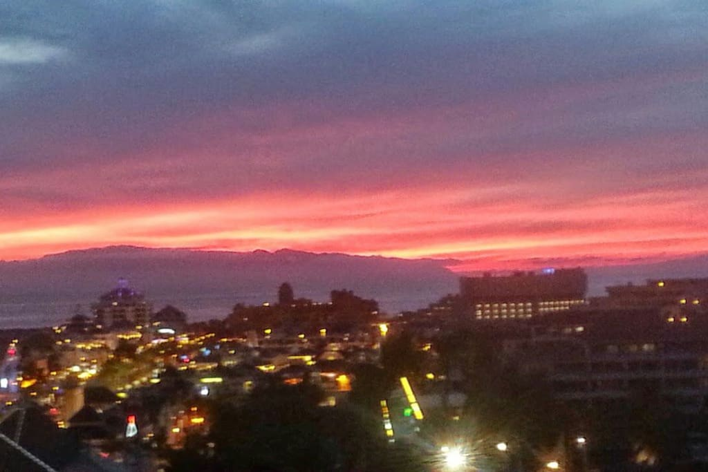Sun goes down over las americas, from your window