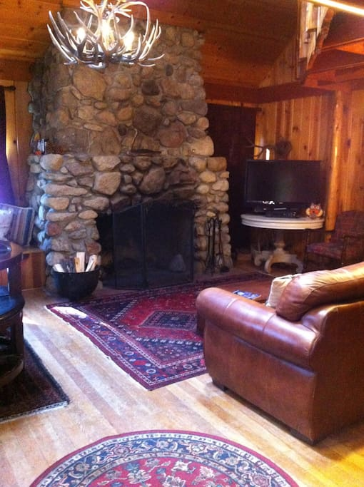 Beautiful large stone fireplace for cozy fires!