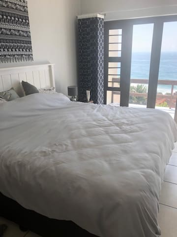 Main Bedroom with folding doors onto the balcony and a magnificent view of the sea