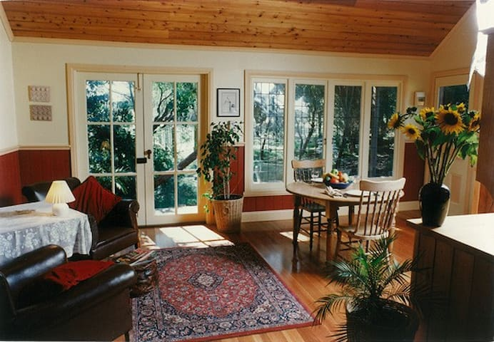 North-facing windows in sitting room open on to rural garden