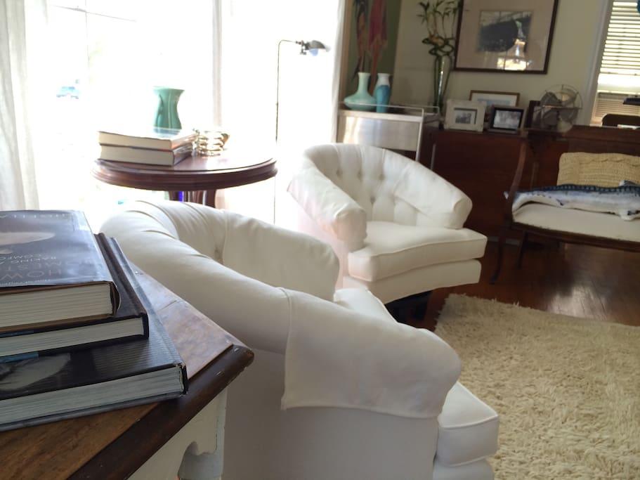 White linen, tufted upholstered chairs added September 2014.