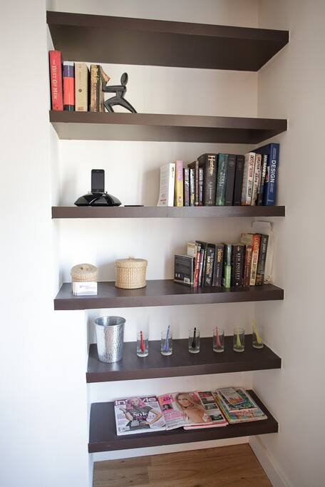 There is an iPhone dock and lots of books, guides and newspapers to read