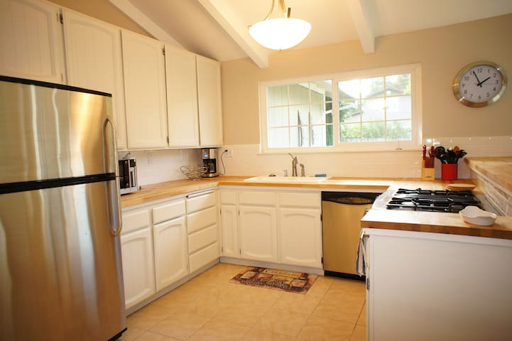 Large open kitchen with oven, 4 burner stove top (with griddle attachment for pancakes!), dishwasher & microwave.