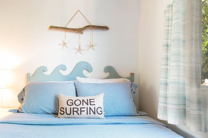 Cottage upper queen bedroom with handmade wave headboard!  Unique touches everywhere you look!